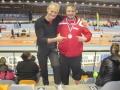 Un adhérent de la section athlétisme avec sa médaille et son entraineur en 2014